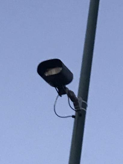 Anyone know what the black slim rectangular cameras are on the lamp