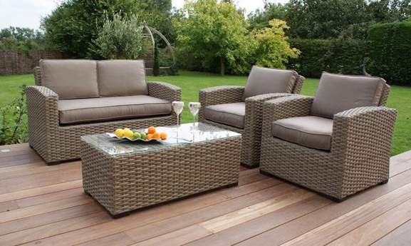 garden area with two rattan armchairs and a rectangular table