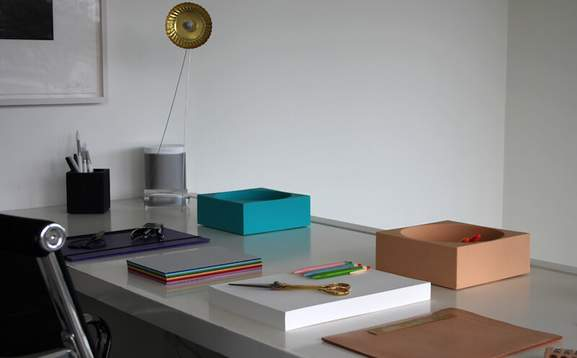 modern and clean working space with a sonos speaker on desk