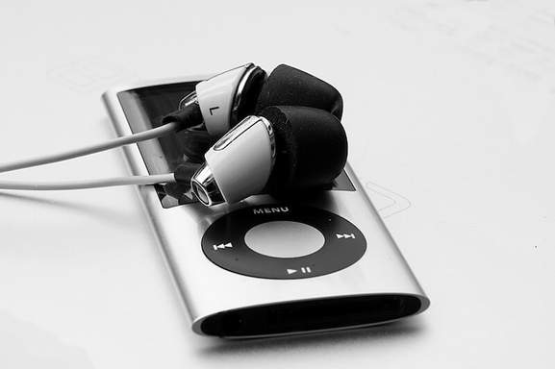 silver ipod nano with earphones
