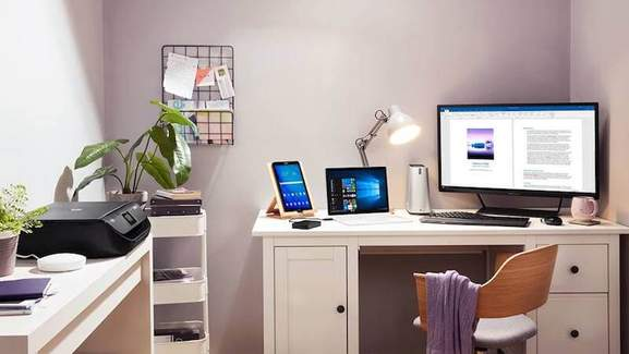 modern styled office room with printer, tablet, laptop and desktop pc from samsung