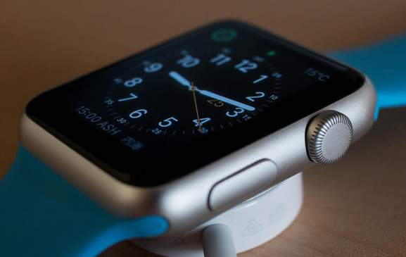 Clock face on Apple Watch with blue strap