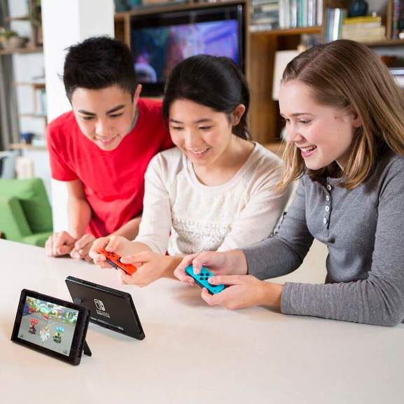 3 Kids playing Mario Kart on the Nintendo Switch using Nintendo Joy-Cons