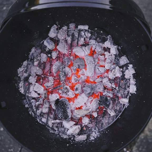 Black BBQ with grey and glowing coals