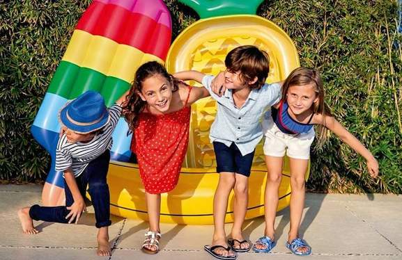 2 boys and 2 girls wearing m&s summer clothes