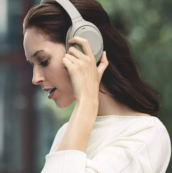 Sony WH-1000XM3 in grey on woman's head