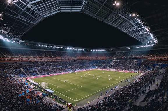 night view of crowded volksparkstadion soccer stadium before the match at night