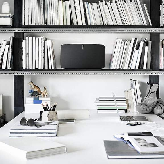 Sonos Play:5 on bookshelf about desk