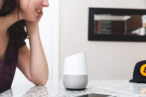 Person using Google Home