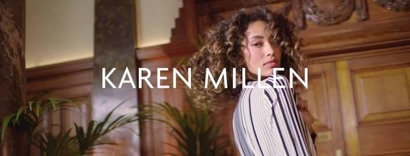 women with curly hair wears karen millen fashion