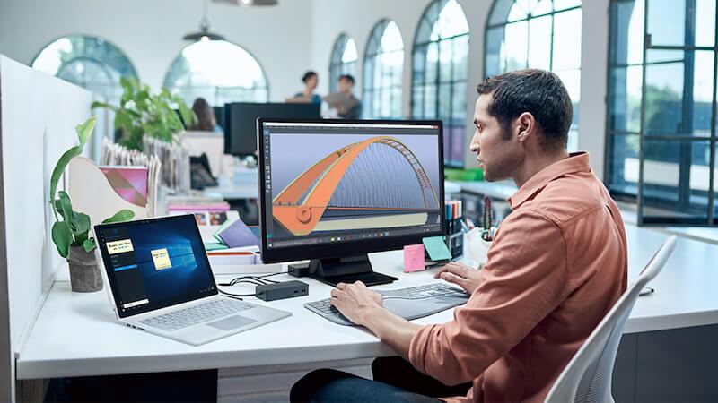 Man using Microsoft Surface Book