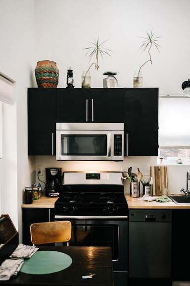 kitchen in black with oven and microwave