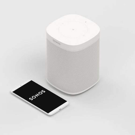 Sonos One White next to iPhone with Sonos App