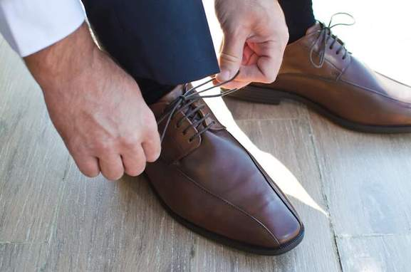 close-up of a man wearing classic brown business shoes