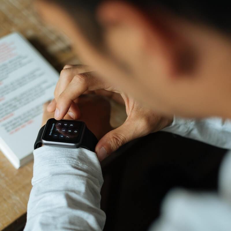 Man with Apple Watch on wrist