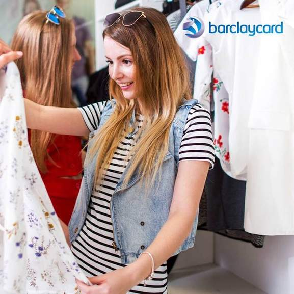 woman is shopping for clothes and barclaycard branding