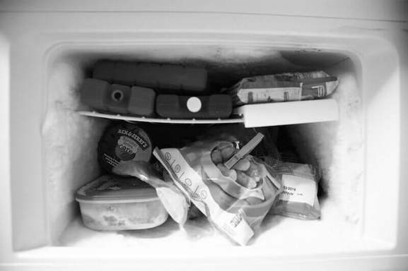 lots of stuff lying in a small freezer