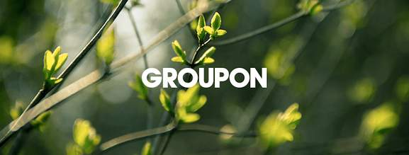 groupon banner with plants in a blurred background