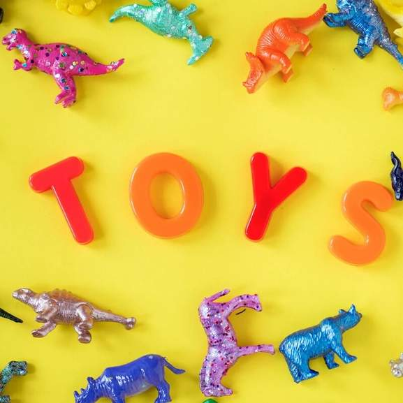 Toys alongside small dinosaurs and animals