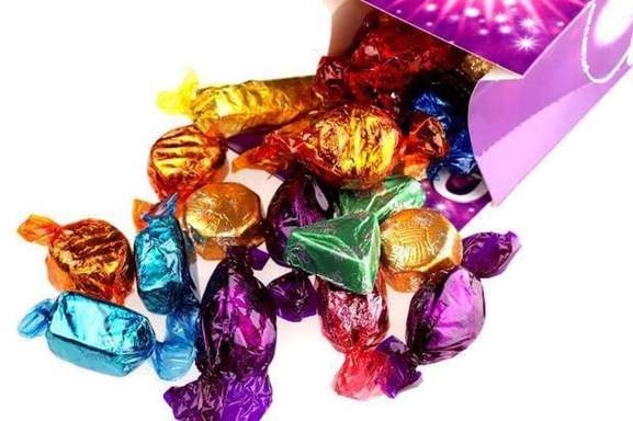 quality street's fudges falling out a box of a