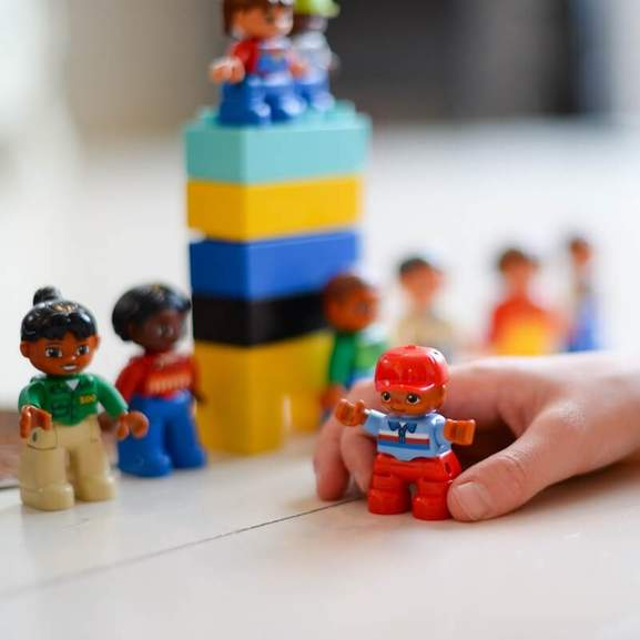 Child playing with duplo figures