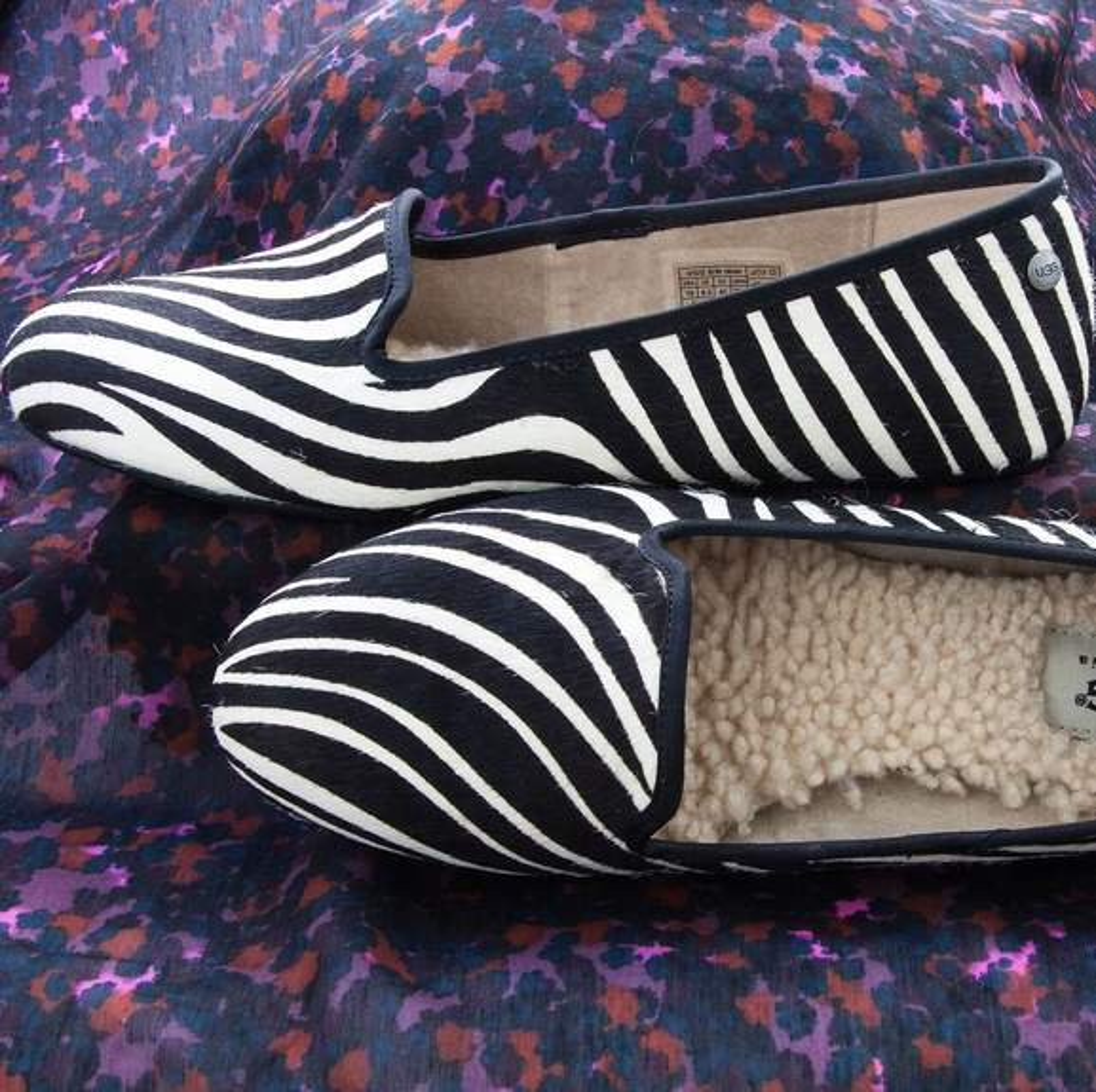 Zebra striped ugg slippers