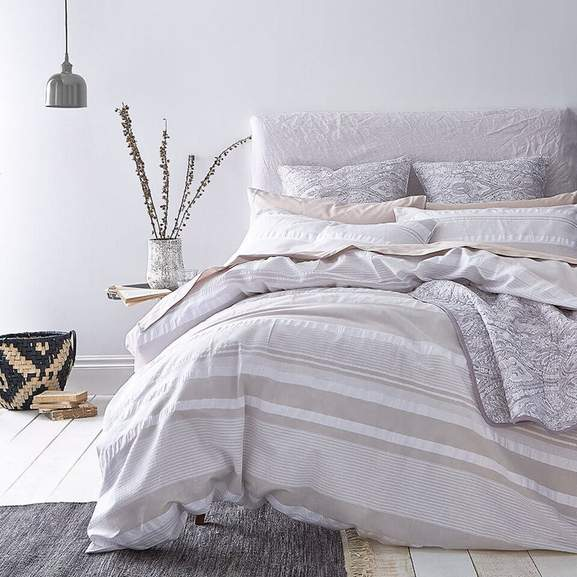 a white bedroom featuring cozy BHS Cotton beddings