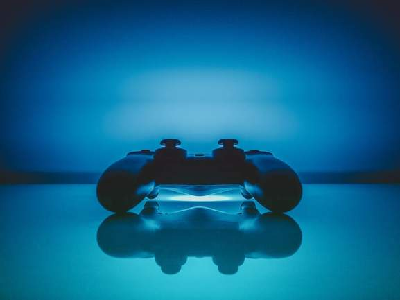 dualshock controller in a blue light