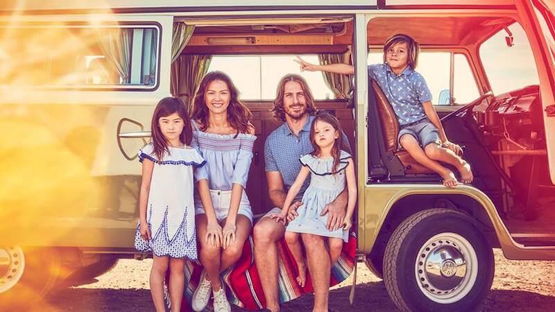family sitting in a van wearing matalan fashion