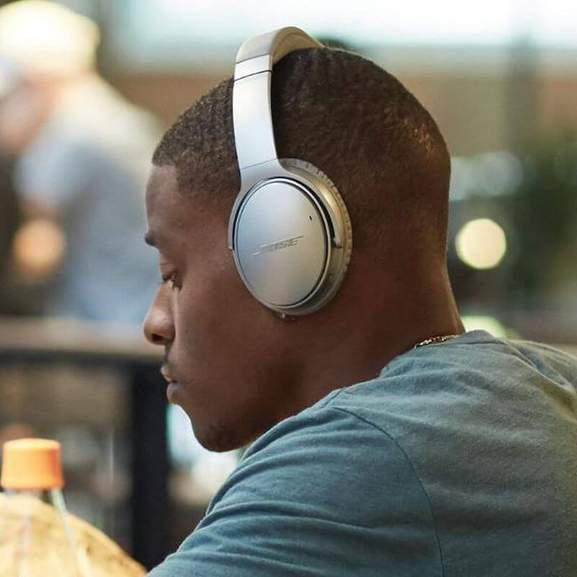 Person wearing Bose QuietComfort 35 in grey