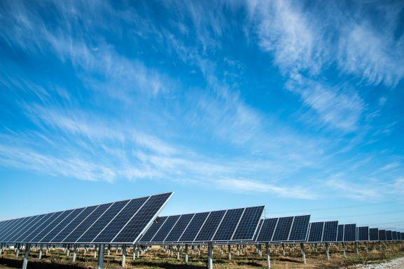 solar panels under a blue sky