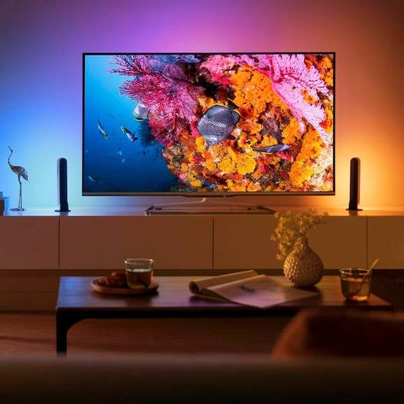 Philips TV with ambilight technology in dark room