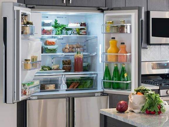 integrated american-style fridge freezer with open doors in a modern kitchen