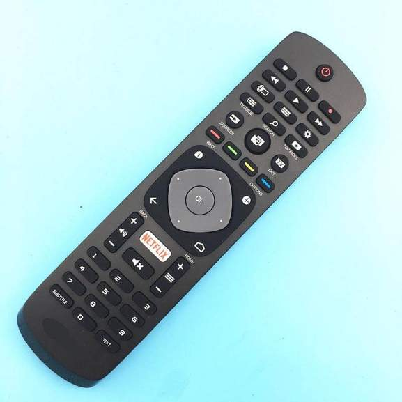 Philips TV remote controller with Netflix button in front of blue background