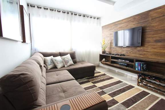 apartment with an led tv hanging on the wall