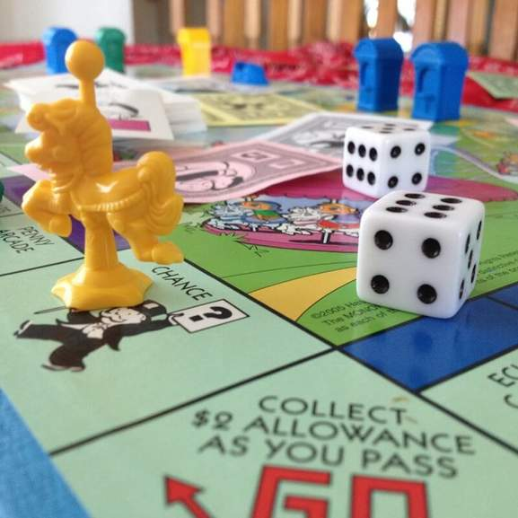 Monopoly Junior game with yellow game piece and dice