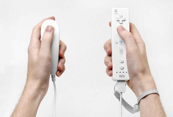 wo hands holding wii nunchuk and remote