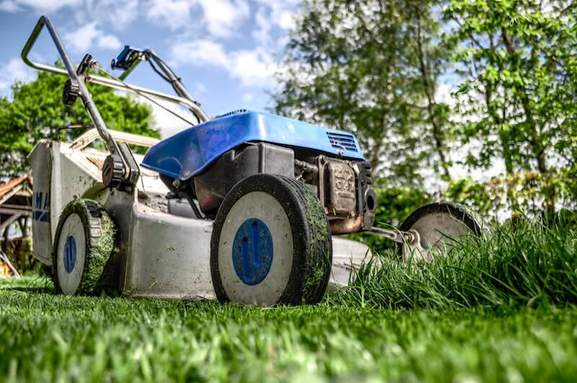 pov lawnmower at work on a lawn