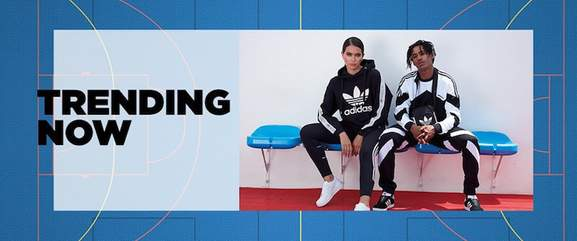 girl and guy wearing adidas track suits next to the saying trending now