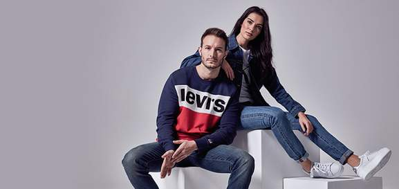 man and woman wearing the hut clothing