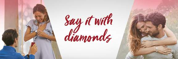 h.samuel banner with two couples left and right and the saying say it with diamonds