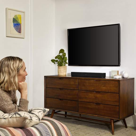 Person looking at TV with Sonos Beam underneath