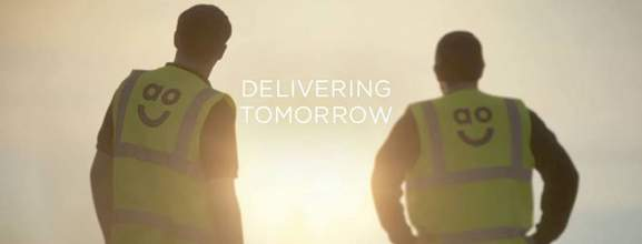 two men wearing ao vests and the saying delivering tomorrow