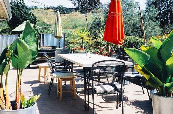 garden table terrace with chairs and two parasols