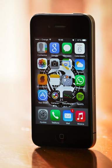 black iphone 4 with ios operating system