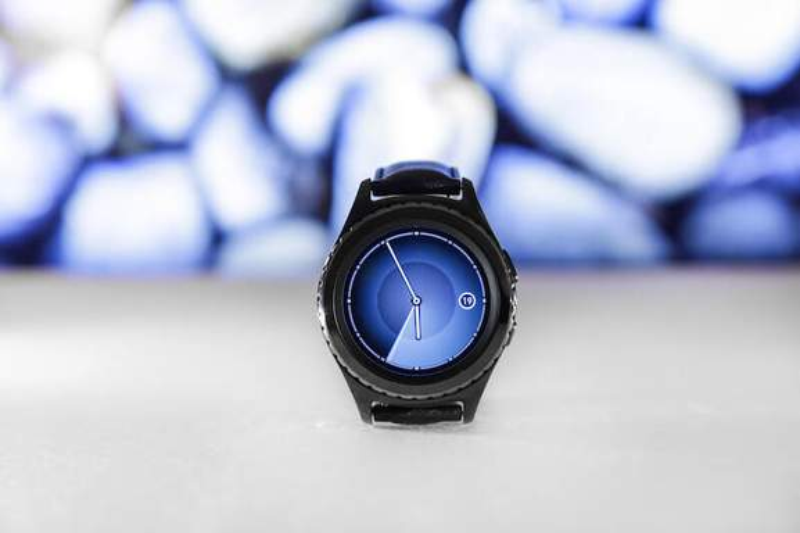 Black Samsung Gear Displaying 05.55 on White Surface