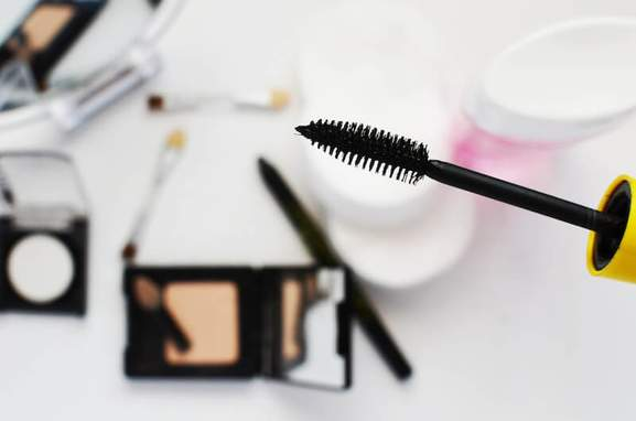 mascara and other make up in blurred background