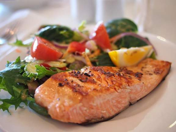 grilled salmon fillet on a white ceramic plate