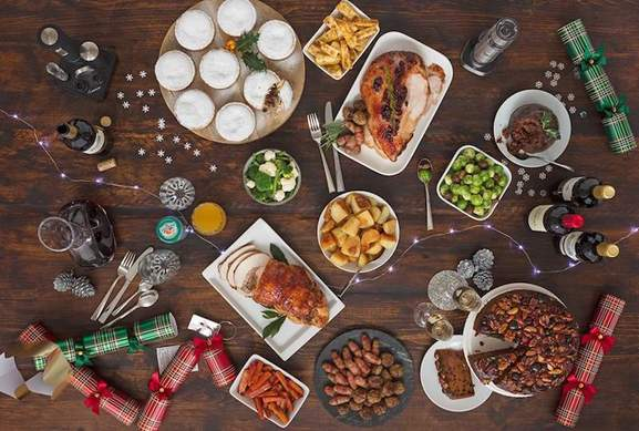 a table full of tasty looking food and drinks with a christmas decoration