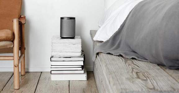 industrial styled bedroom with a white play 1 on a pile of books